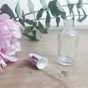 Flacon en verre transparent et pipette